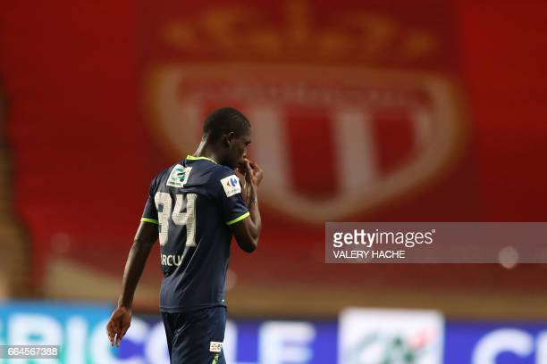 Lille's midfielder Carlens Arcus reacts after receiving a red card during the French Cup football match between Monaco vs Lille at the 'Louis II'...