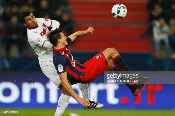 Lille's midfielder Junior Alonso vies for the ball with Caen's Croatian forward Ivan Santini during the French L1 football match between Caen and...
