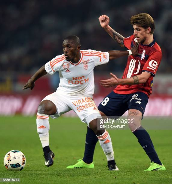 Lille's midfielder Xeka vies with Lorient's Ghanaian forward Abdul Majeed Waris during the French Ligue 1 football match between Lille OSC and...
