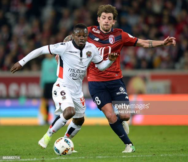 Lille's midfielder Xeka vies with Nice's Ivorian midfielder Jean Michael Seri during the French L1 football match between Lille and Nice at the...