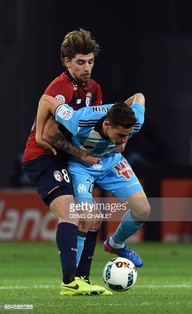 Lille's midfielder Xeka vies with Olympique de Marseille's French midfielder Florian Thauvin during the French L1 football match between Lille OSC...