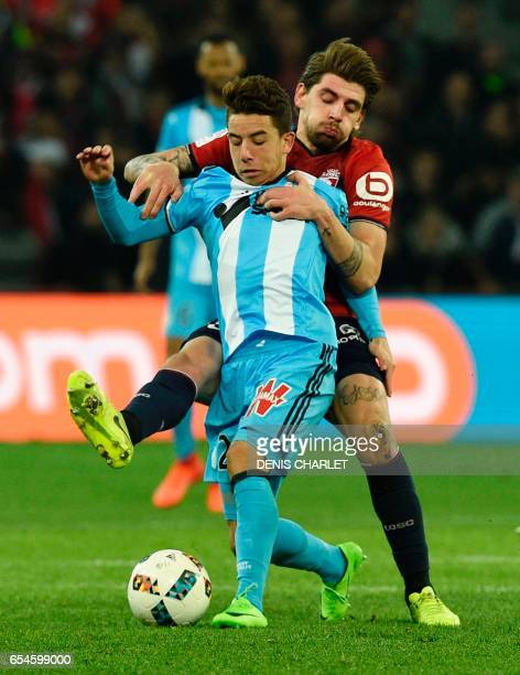 Lille's midfielder Xeka vies with Olympique de Marseille's French midfielder Maxime Lopez during the French L1 football match between Lille OSC and...