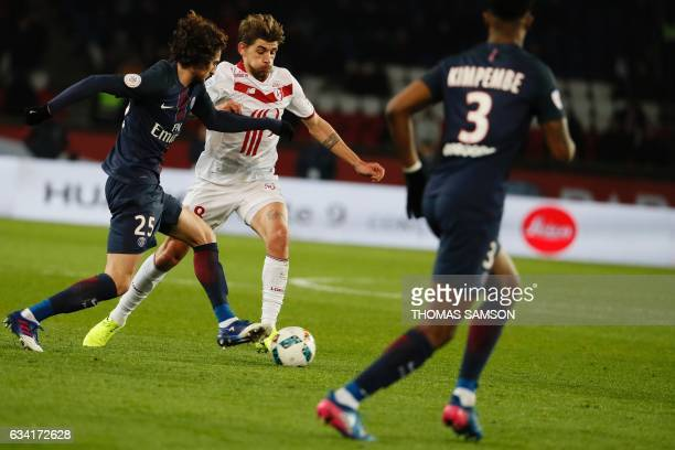 Lille's midfielder Xeka vies with Paris SaintGermain's French midfielder Adrien Rabiot during the French L1 football match between Paris SaintGermain...