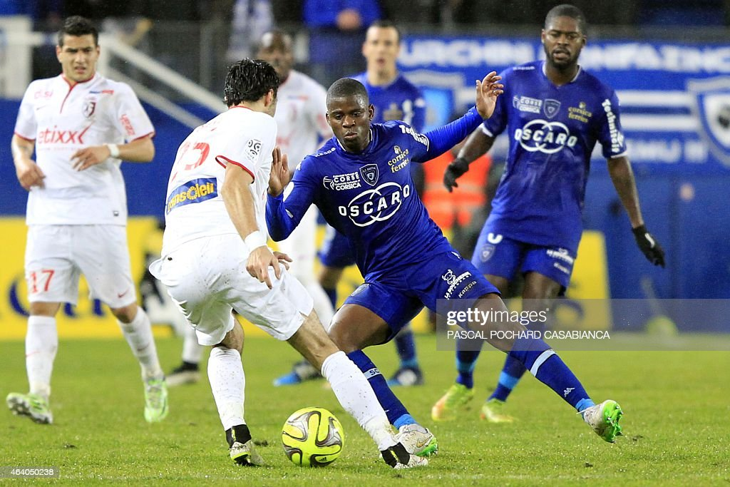 Lille's Montenegran defender Marko Basa vies with Bastia's French midfielder <a gi-track='captionPersonalityLinkClicked' href=/galleries/search?phrase=Floyd+Ayite&family=editorial&specificpeople=5969808 ng-click='$event.stopPropagation()'>Floyd Ayite</a> during the French L1 football match Bastia (SCB) against Lille (LOSC) on February 21, 2015 in the Armand Cesari stadium in Bastia, French Mediterranean island of Corsica. AFP PHOTO / PASCAL POCHARD-CASABIANCA