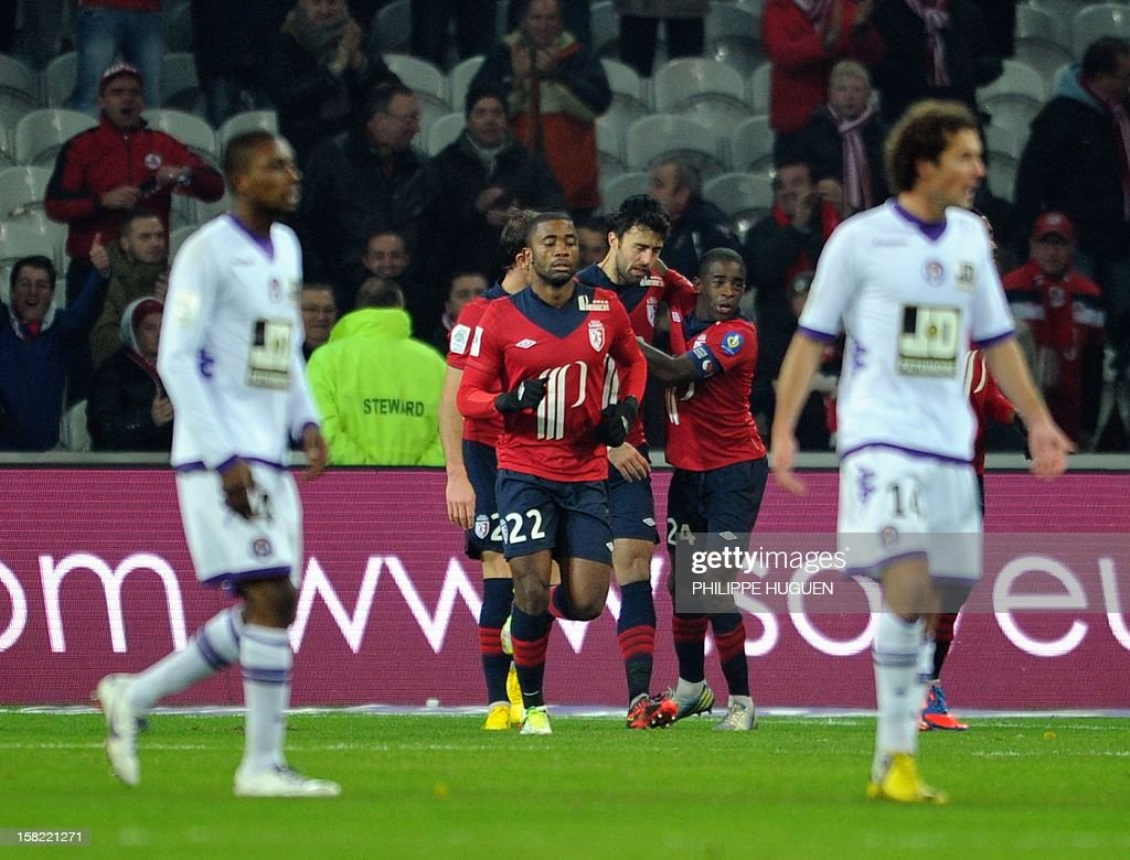 Lille's Montenegrin defender Marko Basa (C) is congratuled by his teammate after scoring a goal during the French L1 football match Lille vs Toulouse on December 11, 2012 at the Grand Stade Stadium in Villeneuve d'Ascq.