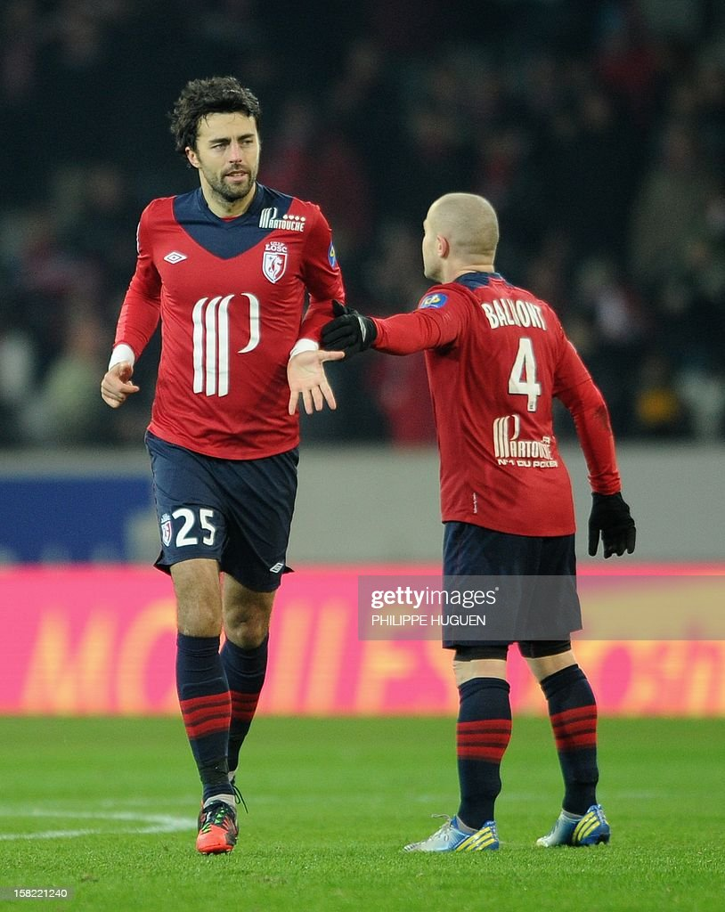 Lille's Montenegrin defender Marko Basa (L) is congratuled by Lille's French midfielder Florent Balmont (R) after scoring a goal during the French L1 football match Lille vs Toulouse on December 11, 2012 at the Grand Stade Stadium in Villeneuve d'Ascq. AFP PHOTO / PHILIPPE HUGUEN