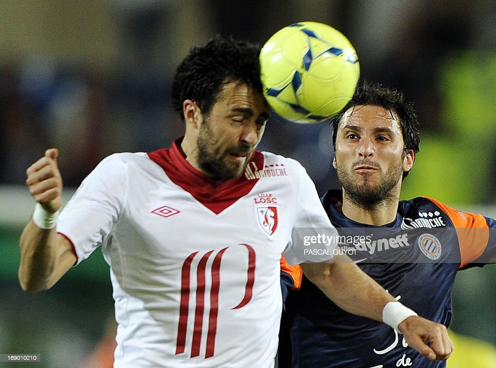 Lille's Montenegrin defender Marko Basa (L) vies for the ball with Montpellier's Argentinian forward Emmanuel Herrera (R) during the French L1 football match Montpellier vs Lille on May 18, 2013 at the Mosson stadium in Montpellier, southern France.