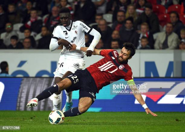 Lille's Montenegrin defender Marko Basa vies with Metz's Senegalese midfielder Ismaila Sarr during the French L1 football match between Lille and...