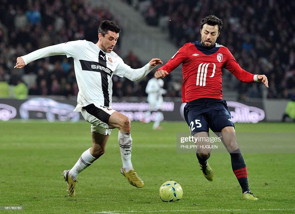Lille's Montenegrin defender Marko Basa (R) vies with Rennes' French midfielder Julien Feret during the French L1 football match Lille vs Rennes on February 15, 2013 at the Grand Stade Stadium in Villeneuve d'Ascq.