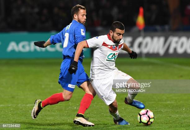 Lille's Naim Sliti vies with Bergerac's Victor Fuchs during the French Cup football match between Bergerac and Lille on March 2 2017 at the...