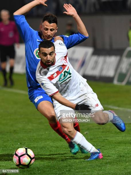 Lille's Naim Sliti vies with Bergerac's Youssef Zidane during the French Cup football match between Bergerac and Lille on March 2 2017 at the...