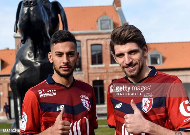 Lille's new players Dutch forward Ricardo Kishna and Portuguese midfielder Xeka pose for pictures following a press conference at the training...