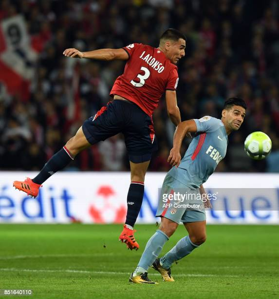 Lille's Paraguayan defender Junior Alonso vies with Monaco's Colombian forward Radamel Falcao during the French L1 football match between Lille OSC...