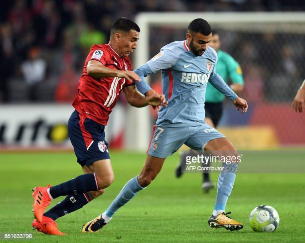Lille's Paraguayan defender Junior Alonso vies with Monaco's midfielder Rchid Ghezzal during the French L1 football match between Lille OSC and...