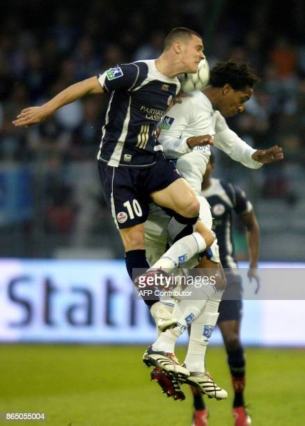 Lille's player Ludovic Obreniak fights for the ball with Auxerre's player Frédéric Thomas during their French L1 football match 19 May 2007 at the...