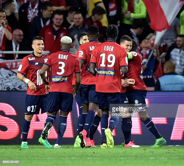 Lille's players celebrate after scoring a goal during the French L1 football match between Lille and Nantes at the PierreMauroy Stadium in Villeneuve...