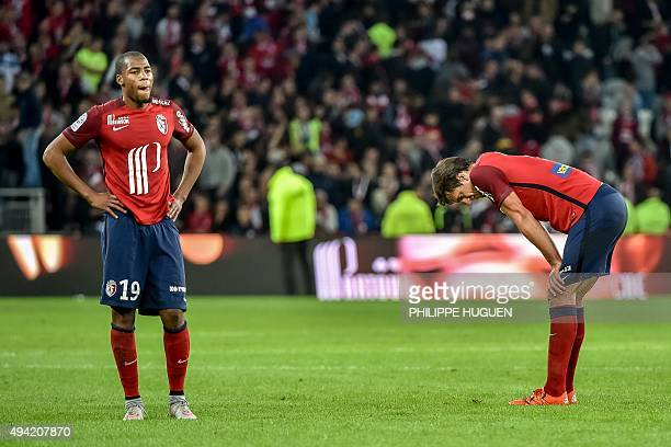 Lille's players react at the end of the French Ligue 1 football match between Lille and Marseille on October 25 2015 at the Pierre Mauroy Stadium in...
