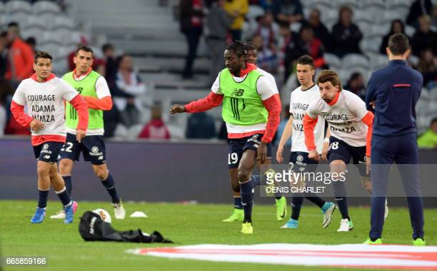 Lille's players warm up before the French L1 football match between Lille OSC and Nice at the PierreMauroy Stadium in Villeneuve d'Ascq near Lille...