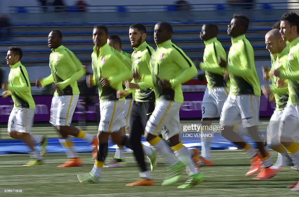 Lille's players warm up prior to the French L1 football match between Lorient (FCL) and Lyon (OL) at the Moustoir Stadium in Lorient, western France, on April 30, 2016.