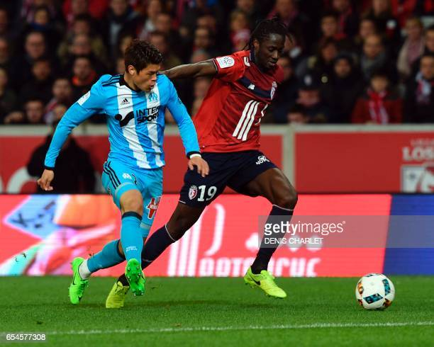 Lille's Portuguese forward Eder vies with Olympique de Marseille's Japanese defender Hiroki Sakai during the French L1 football match between Lille...