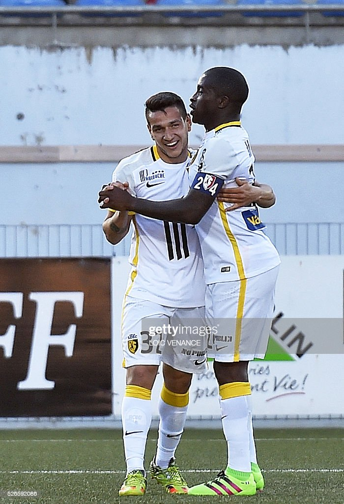 Lille's Portuguese midfielder Rony Lopes (L) is congratulated after scoring during the French L1 football match Lorient vs Lyon at the Moustoir stadium in Lorient, western France, on April 30, 2016.