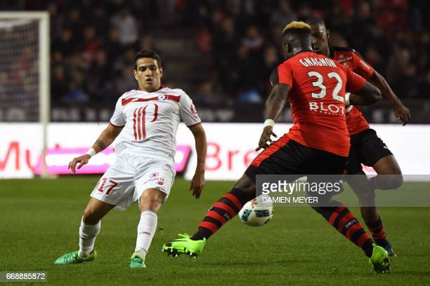 Lille's Portuguese midfielder Rony Lopes kicks the ball close to Rennes' French defender Joris Gnagnon during the French L1 football match Rennes...