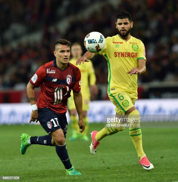 Lille's Portuguese midfielder Rony Lopes vies with Nantes' Brazilian defender Lima during the French L1 football match between Lille OSC and Nantes...