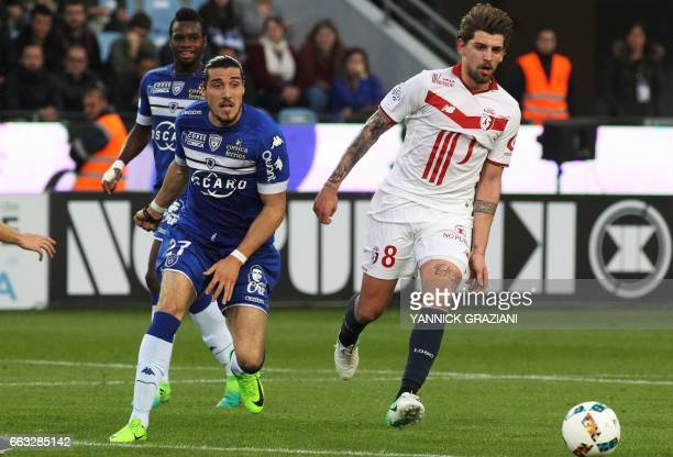 Lille's Portuguese midfielder Xeka vies with Bastia's French forward Enzo Crivelli during the L1 football match Bastia against Lille on April 1 at...