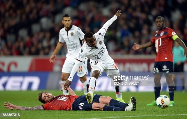 Lille's Portuguese midfielder Xeka vies with Nice's Ivorian midfielder Jean Michael Seri during the French L1 football match between Lille and Nice...