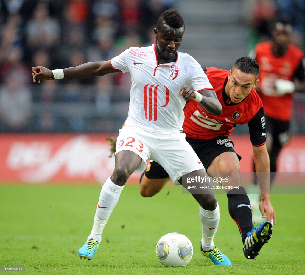 Lille's Senegalese defender Pape Souare (L) vies with Rennes' French forward Mevlut Erding (R) during the French L1 football match Rennes (SRFC) vs Lille (LOSC) on August 31, 2013 at the Route de Lorient stadium in Rennes, western France. AFP PHOTO / JEAN-FRANCOIS MONIER.