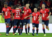 Lille's Senegalese midfielder Idrissa Gueye celebrates with teammates after scoring during a french L1 football match Lille vs Ajaccio on October 05...