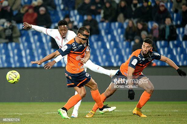 Lille's Senegalese midfielder Idrissa Gueye vies for the ball with Montpellier's Brazilian defender Vitorino Hilton and Montpellier's French Morrocan...