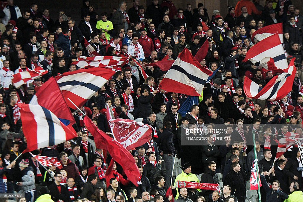 Lille's supporters wave flags during the French L1 football match between Lille (LOSC) and Rennes (SRFC) on February 7, 2016 at the Pierre-Mauroy stadium in Lille, northern France. AFP PHOTO / FRANCOIS LO PRESTI / AFP / FRANCOIS LO PRESTI