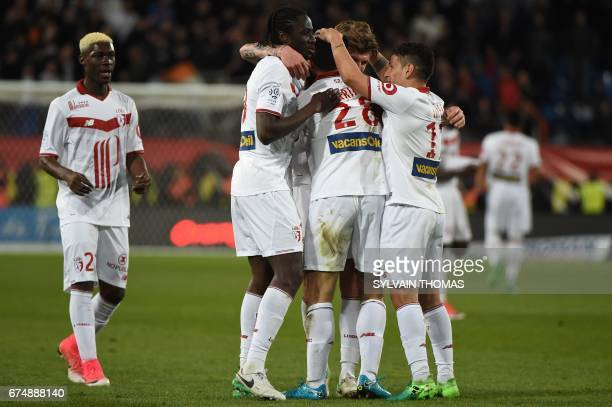 Lilles's french forward Martin Terrier celebrates with his teammates after scoring during the French L1 football match Montpellier vs Lille at the...