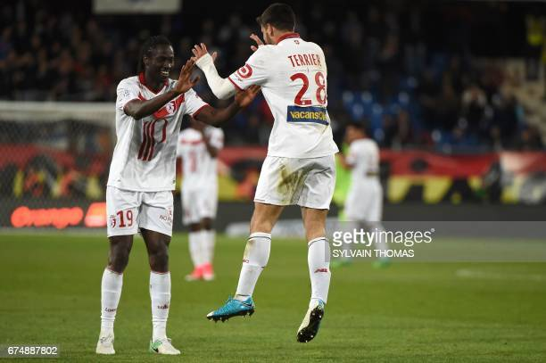 Lilles's french forward Martin Terrier celebrates with Lilles's portuguese forward Eder after scoring during the French L1 football match Montpellier...