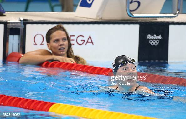 Lillia King of USA celebrates winning the gold medal while Yulia Efimova of Russia looks on in the women's 100m breaststroke final on day 3 of the...