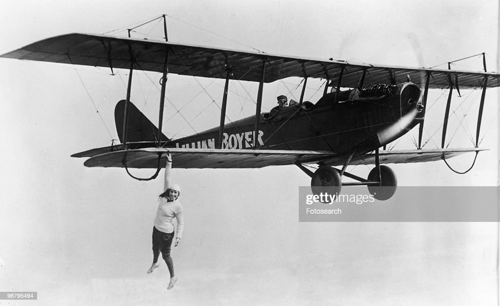 Lillian Boyer hanging off the wing of a flying airplane, circa 1923. (Photo by Fotosearch/Getty Images).