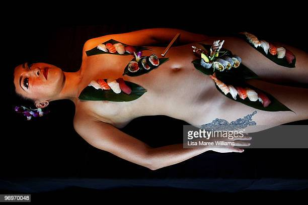 Lillian Starr is decorated with sushi during a press conference at the Toko Restaurant Bar for New York artist Spencer Tunick on February 23 2010 in...