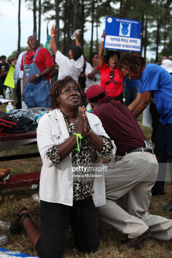 Lillie Sutton prays after hearing that there is a delay, not a stay, in the execution of Troy Davis as protestors gather at Jackson State Prison for the planned execution of inmate Troy Davis on September 21, 2011 in Jackson, Georgia. The Georgia Board of Pardons and Paroles denied clemency for death row inmate Troy Davis on Tuesday morning. Davis is scheduled for execution at 7pm on Wednesday, September 21, 2011 for the 1989 slaying of off-duty Savannah, Ga., police officer Mark MacPhail. Controversy over Davis' guilt has drawn national attention to the case.