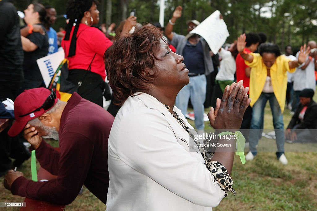 Lillie Sutton (C) prays after hearing that there is a delay, not a stay, in the execution of Troy Davis as protestors gather at Jackson State Prison for the planned execution of inmate Troy Davis on September 21, 2011 in Jackson, Georgia. The Georgia Board of Pardons and Paroles denied clemency for death row inmate Troy Davis on Tuesday morning. Davis is scheduled for execution at 7pm on Wednesday, September 21, 2011 for the 1989 slaying of off-duty Savannah, Ga., police officer Mark MacPhail. Controversy over Davis' guilt has drawn national attention to the case.