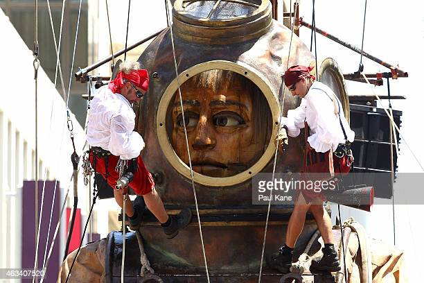 Lilliputians prepare the Diver Giant for a drink with the firemen on Hay Street during the Perth International Arts Festival on February 14 2015 in...