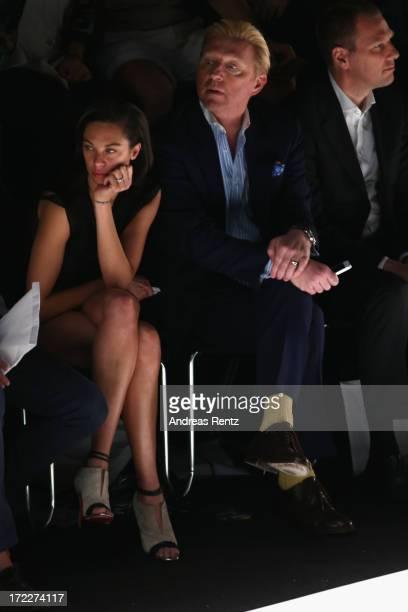 Lilly Becker and Boris Becker attend the Malaikaraiss Show during MercedesBenz Fashion Week Spring/Summer 2014 at Brandenburg Gate on July 2 2013 in...