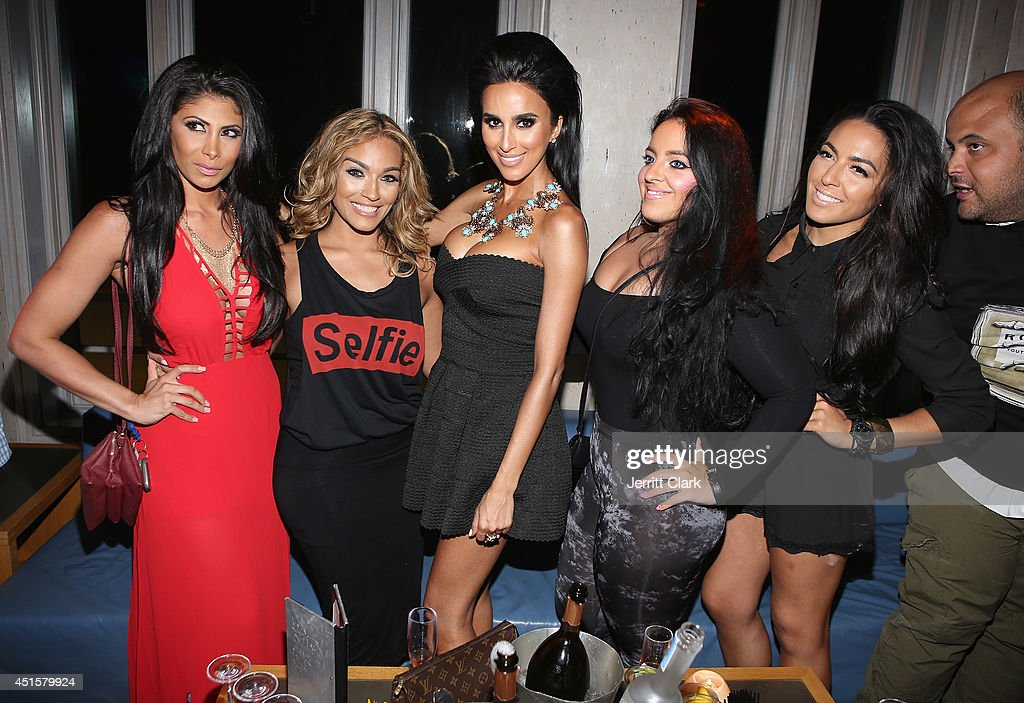 <a gi-track='captionPersonalityLinkClicked' href=/galleries/search?phrase=Lilly+Ghalichi&family=editorial&specificpeople=8521894 ng-click='$event.stopPropagation()'>Lilly Ghalichi</a> (C) poses with friends at Avenue Nuit on June 28, 2014 in Long Branch, New Jersey.