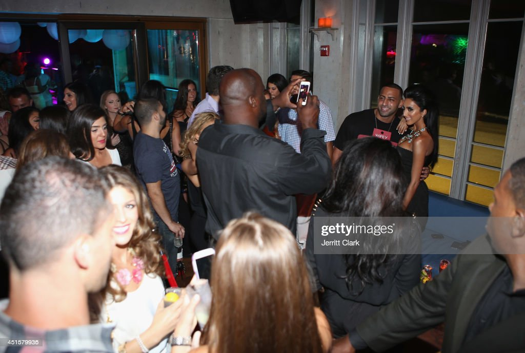 <a gi-track='captionPersonalityLinkClicked' href=/galleries/search?phrase=Lilly+Ghalichi&family=editorial&specificpeople=8521894 ng-click='$event.stopPropagation()'>Lilly Ghalichi</a> poses with friends at Avenue Nuit on June 28, 2014 in Long Branch, New Jersey.