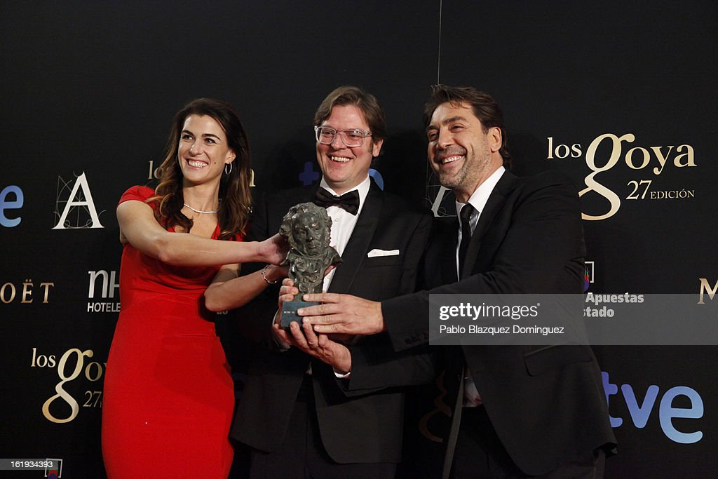 Lilly Hartley, Alvaro Longoria and <a gi-track='captionPersonalityLinkClicked' href=/galleries/search?phrase=Javier+Bardem&family=editorial&specificpeople=209334 ng-click='$event.stopPropagation()'>Javier Bardem</a> holds his award for Best Documentary Flim in the film 'Hijos de las Nubes, La Ultima Colonia' during the 2013 edition of the 'Goya Cinema Awards' ceremony at Centro de Congresos Principe Felipe on February 17, 2013 in Madrid, Spain.