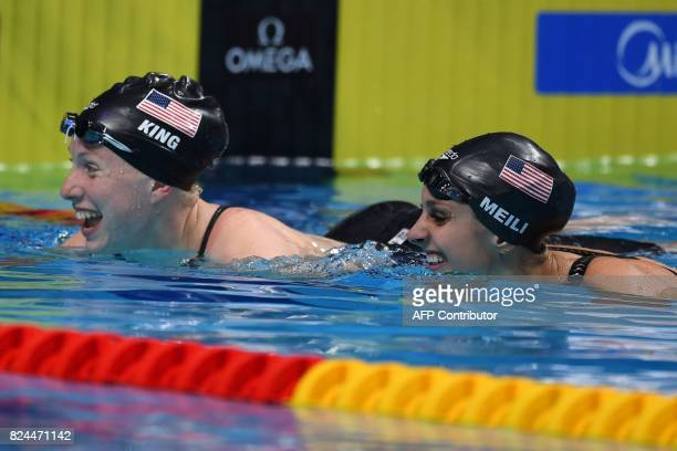 US Lilly King and US Katie Meili reacts after competing in the final of the women's 50m breaststroke during the swimming competition at the 2017 FINA...