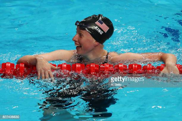 Lilly King of the United States celebrates after winning the gold medal in a world record time of 10413 during the Women's 100m Breaststroke final on...