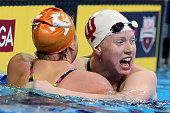 Lilly King of the United States celebrates with Molly Hannis of the United States after finishing first in the final heat for the Women's 200 Meter...