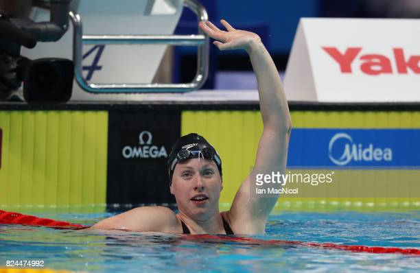 Lilly King of United States celebrates victory in the Women's 50m Freestyle final during day seventeen of the FINA World Championships at the Duna...