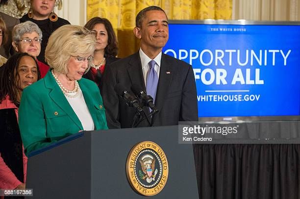 Lilly Ledbetter speaks in the East Room of the White House along with US President Barack Obama before he signs an executive order banning federal...